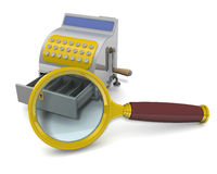 Magnifying glass and an empty cash register Royalty Free Stock Image