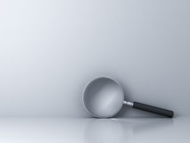 Magnifying Glass on empty white wall background Royalty Free Stock Images