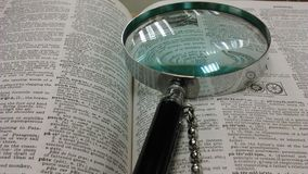 Magnifying glass and encyclopedia Royalty Free Stock Photos