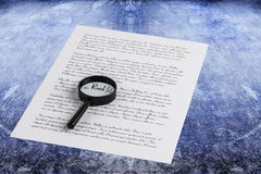 Magnifying glass enlarging the word Read on a page with printed Stock Photo