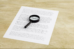 Magnifying glass enlarging the word Search on a page with printe stock photography