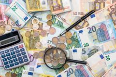 magnifying glass and euro banknotes, euro Stock Images