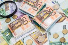 Magnifying glass and euro banknotes, euro Stock Photos