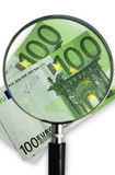 Magnifying glass with euro bill Royalty Free Stock Image
