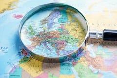 Magnifying glass on europe world globe map