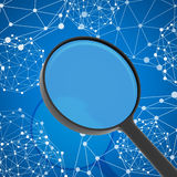 Magnifying glass examines network in background Royalty Free Stock Photo