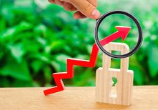 A magnifying glass explores the red up arrow and padlock. Conceptual growth of the level and quality of protection stock image