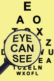Magnifying glass and eye test Stock Photos