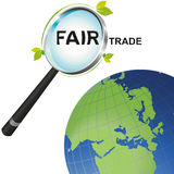 Magnifying glass Fair Trade looking at the world Stock Photo