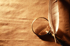 Magnifying Glass And Feather stock image