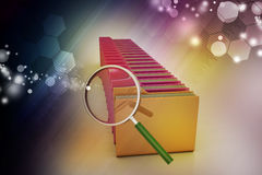 Magnifying glass with file folder Stock Photos
