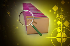 Magnifying glass with file folder Stock Photography