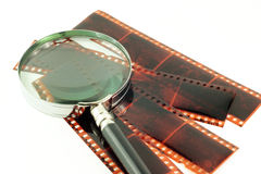 Magnifying glass and film Royalty Free Stock Photography