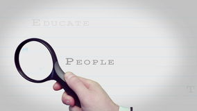 Magnifying glass finding training and human resource buzz words Royalty Free Stock Image