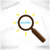 A magnifying glass finds the word Be possible. A magnifying glass finds the word  Be possible  among many instances of Impossible symbolizing a unique positive Stock Photo