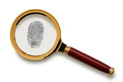 Magnifying glass with fingerprint. Royalty Free Stock Image