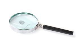 Magnifying glass and fingerprint Stock Photos