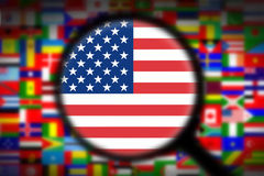 Magnifying glass on the flag of the USA Royalty Free Stock Photo