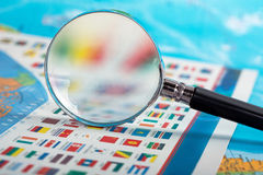 Magnifying glass on the flags Royalty Free Stock Photography