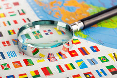 Magnifying glass on the flags Royalty Free Stock Photos
