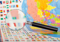 Magnifying glass on the flags Stock Photography