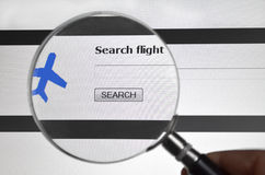 Magnifying glass on Flight Search service. Search flight, airline search service on the web Stock Photography