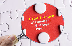 Magnifying glass focus on Excellent credit score evaluation form. Magnifying glass focusing on Excellent credit score evaluation form stock photo