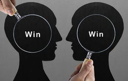 Magnifying glass focus on WIN-WIN situation Royalty Free Stock Photos