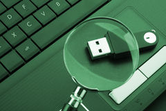 Magnifying glass focused on the flash drive. Magnifying glass focused on the removable flash drive Stock Images