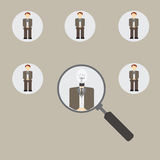 Magnifying glass focused on a person. Royalty Free Stock Images