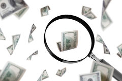 Magnifying Glass Focusing on Dollar Banknote Stock Image