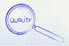 Magnifying glass focusing on quality. Magnifying glass seeking or focusing on quality Stock Photo