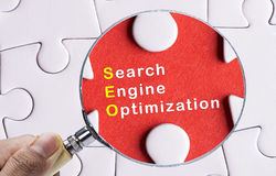 Magnifying glass focusing on SEO Royalty Free Stock Photo