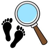 Magnifying Glass with Foot Prints Royalty Free Stock Image
