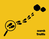 Magnifying glass with footstep. Search truffle. Stock Images
