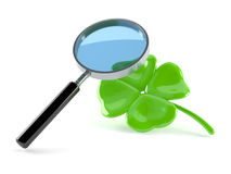 Magnifying glass with four leaf clover Royalty Free Stock Images