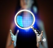 Magnifying Glass on futuristic  hologram Royalty Free Stock Photography