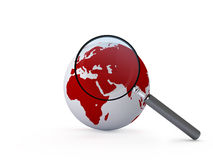 Magnifying Glass and Globe Stock Image