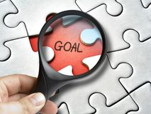 Magnifying glass goal missing tile of the puzzle. Magnifying glass on goal missing tile of the puzzle royalty free stock image