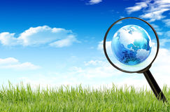 Magnifying glass on the grass Stock Photography