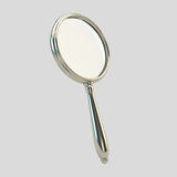 Magnifying glass on gray. Metal magnifying glass on gray background royalty free illustration