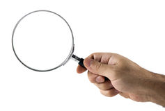Magnifying glass in hand Stock Image