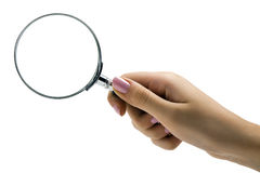 Magnifying glass in hand Stock Photos