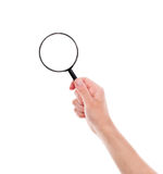 Magnifying glass in hand Royalty Free Stock Photo
