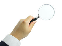 Magnifying Glass In Hand. Magnifying glass in businessman hand isolated on white background stock image