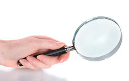 Magnifying glass in hand Royalty Free Stock Image