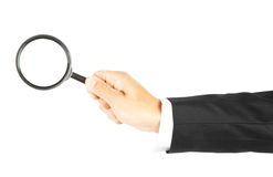 Magnifying glass in hand Stock Photography