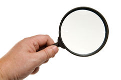 Magnifying glass in hand Royalty Free Stock Photos
