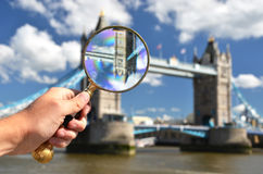 Magnifying glass in the hand Stock Photography