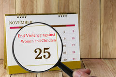 Magnifying glass in hand on calendar you can look International Stock Photo